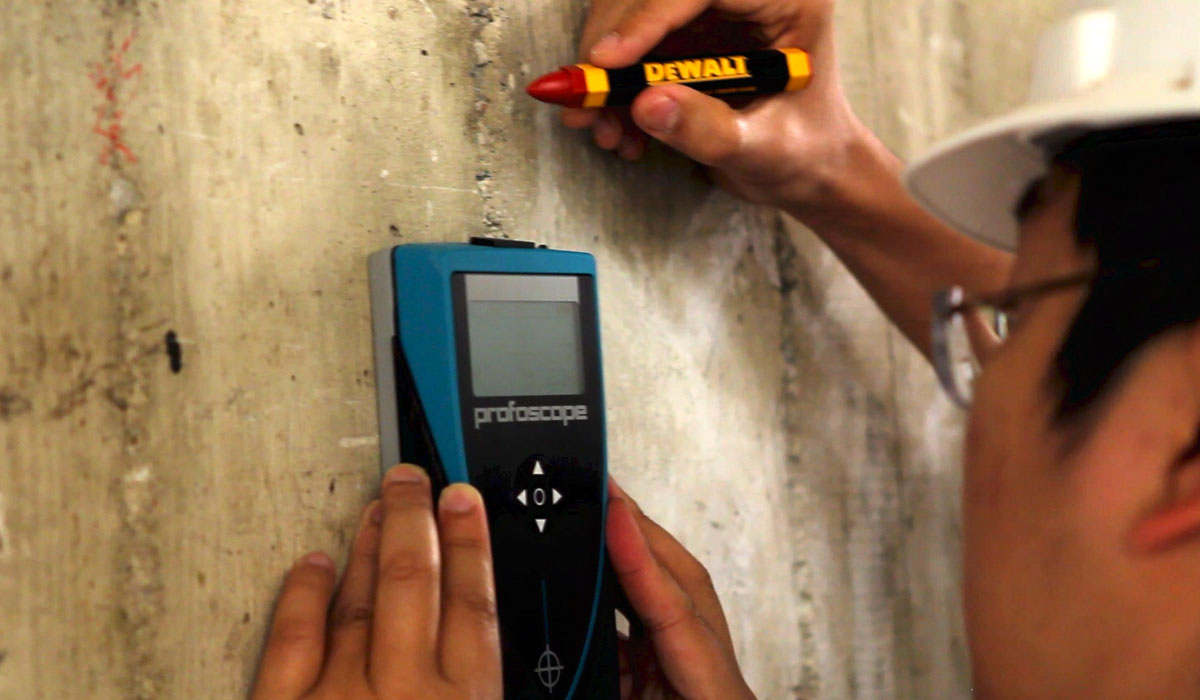 Licensed engineers mapping rebar in non-ductile concrete column