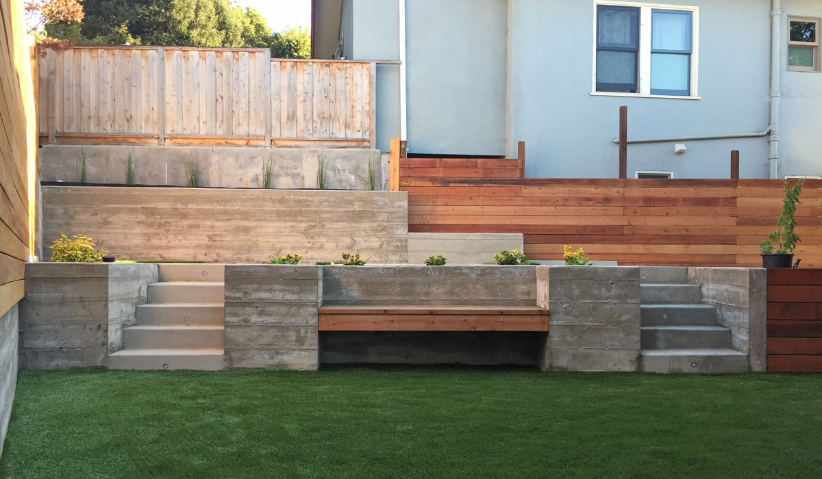 Structural engineering for retaining wall with built-in planter